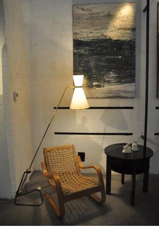 Pierre Guariche, floor lamp; Alvar Aalto, armchair; Jules Leleu, coffee table