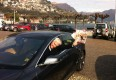 Where Milan's Editor in Chief waving with a copy of the magazing from a Tesla car, after a Go!Excellence tour