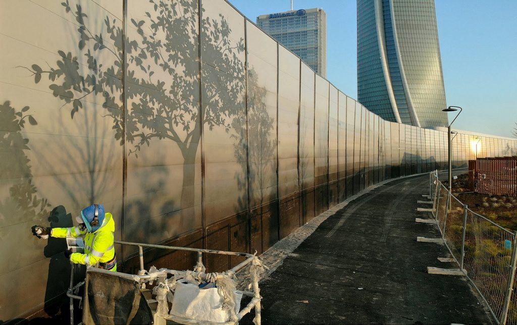 Eron at work on his wall in the City Life district