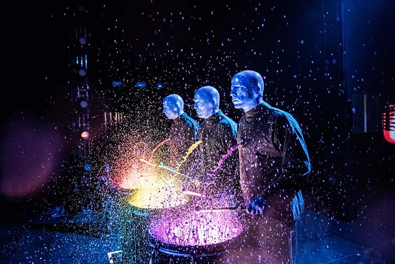 A moment during a live performance by Blue Man Group
