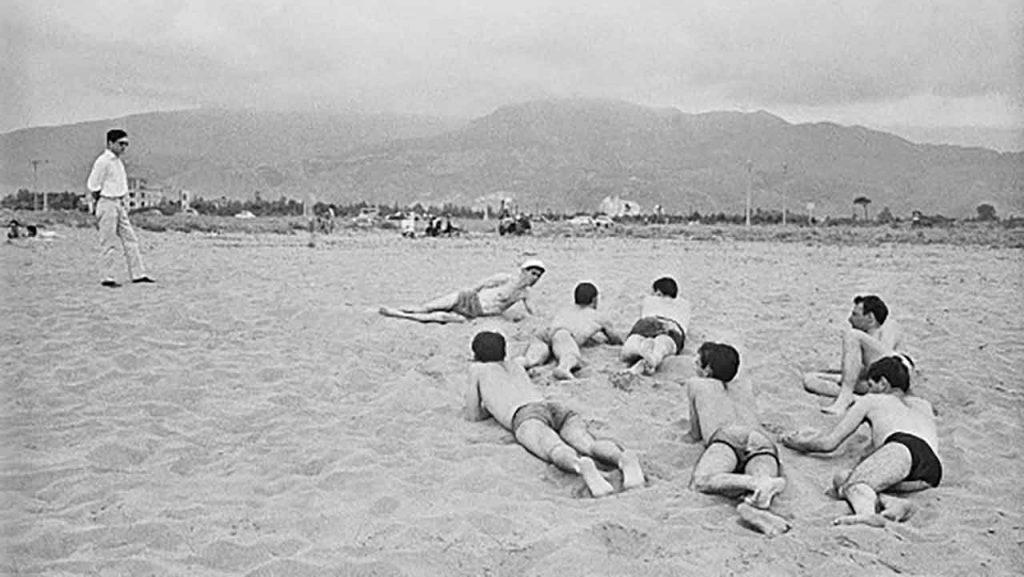 Pier Paolo Pasolini on the beach of Cinquale (Versilia), 1959 ©Archivio Fotografico Paolo Di Paolo
